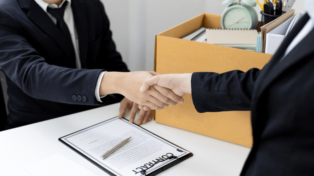 hand shaking on contract